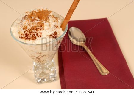 Glass Of Rice Pudding With Cinnamon With A Maroon Napkin