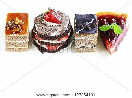 Assorted desserts, cakes and pastries on a white background