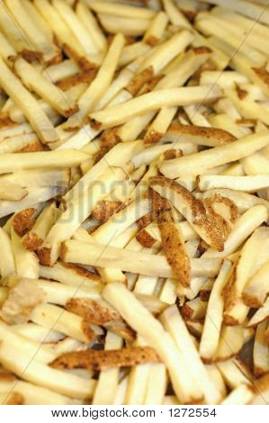 A Group Of Raw French Fries