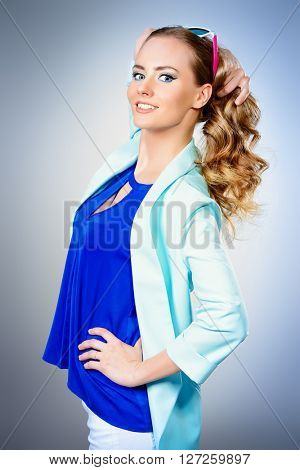 Bright summer style. Pretty young woman with beautiful smile. Cosmetics, bright make-up.