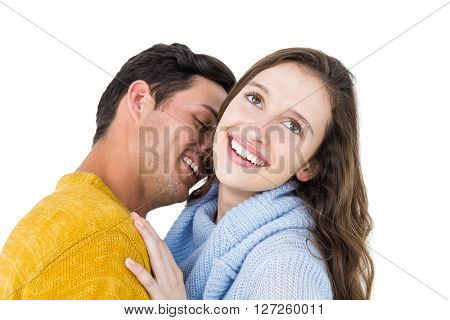 Smiling couple embracing and kissing on white background