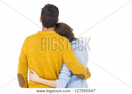 Rear view of a couple embracing on white background