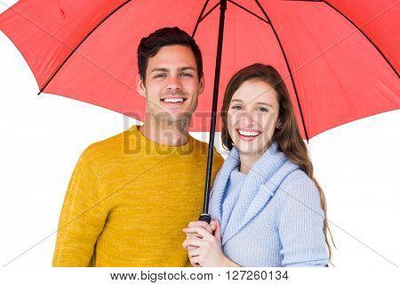 Happy couple holding an umbrella on white background