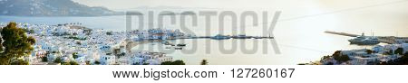 Panorama of traditional greek village with white houses and Mediterranean sea on Mykonos Island, Greece, Europe