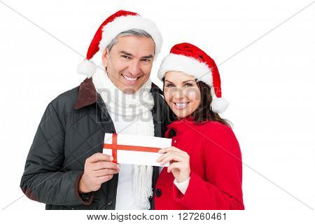 Festive couple holding christmas gift on white screen