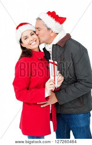 Festive couple exchanging christmas gift on white screen