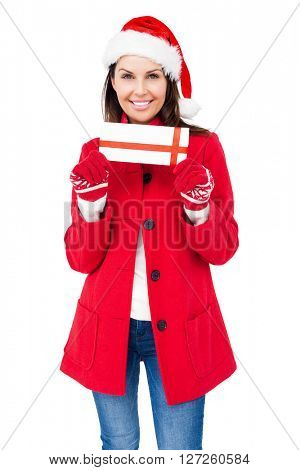 Beautiful brunette holding a christmas gift on white background