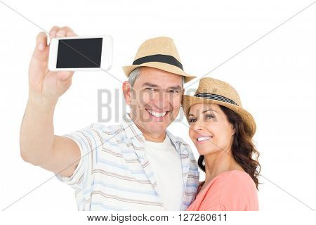Cute couple taking selfie over white background