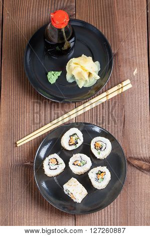 Uramaki sushi with carrot cucumber surimi and roasted white sesame. Shallow dof