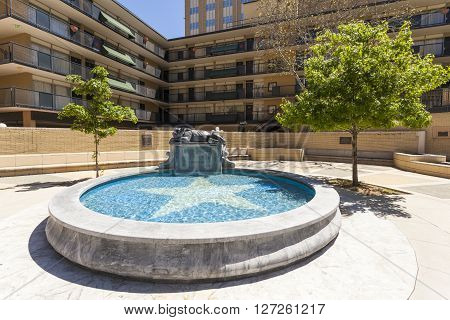 FORT WORTH TX USA - APR 6: Fort Worth Panther City sculpture and pond. April 6 2016 in Fort Worth Texas USA