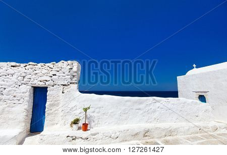 Typical greek traditional village with white walls and colorful doors on Mykonos Island, Greece, Europe