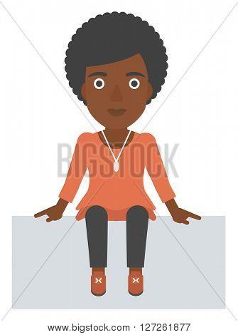 Smiling woman sitting.