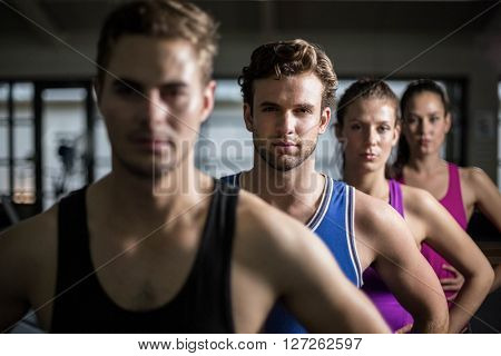 Fit people with hands on hips at gym