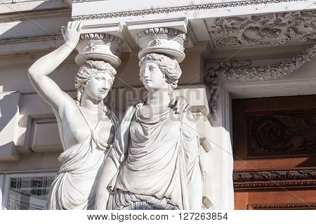 Statues Of Two Young Women In Form Of Columns