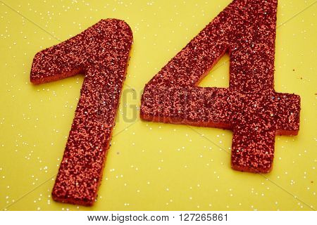 Number fourteen red color over a yellow background. Anniversary. Horizontal