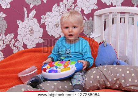 Portrait of blonde baby boy at home