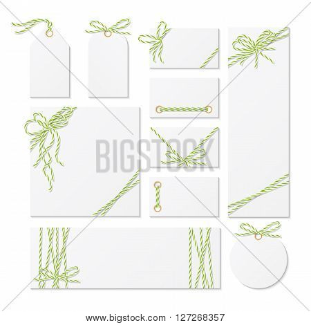 Set of cards, tags and labels tied up with yellow green bakers twine bows and ribbons