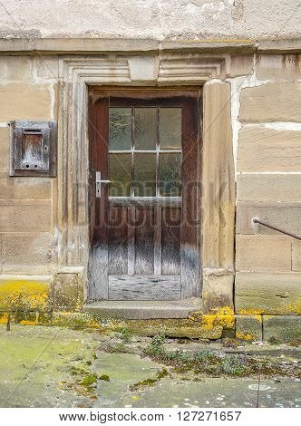 door of a rundown old farmhouse in Southern Germany
