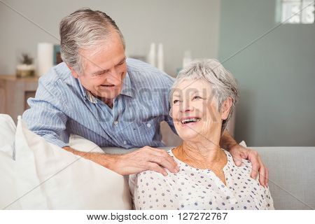 Romantic senior man with his wife sitting at home