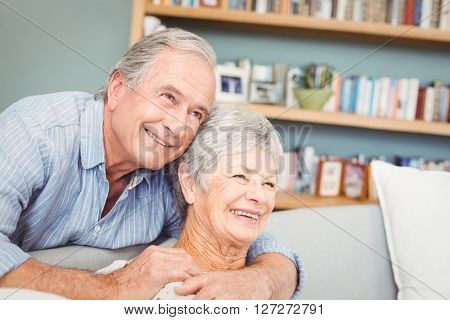 Romantic senior couple hugging at home