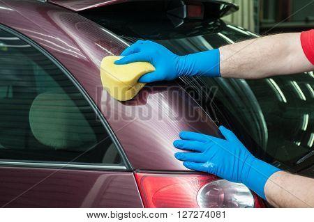 washing car with sponge