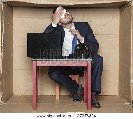 Businessman Suffocating With The Heat