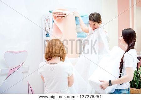 Seamstresses Choose Fabric