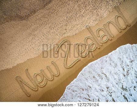 New Zealand written on the beach