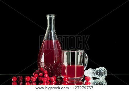 Red liquor, cranberry juice, cranberry juice Isolated on a black background.