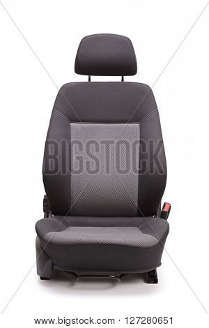 Vertical studio shot of a brand new black car seat isolated on white background