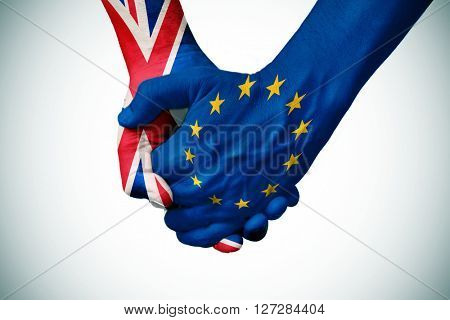 two persons holding hands patterned with the flag of the United Kingdom and the flag of the European Community, with a vignette added