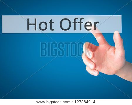 Hot Offer - Hand Pressing A Button On Blurred Background Concept On Visual Screen.