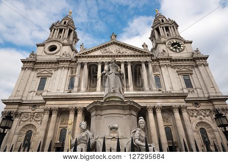 St Paul's Cathedral in London against a cloudy blue sky. Showing the front facade by Sir Christopher Wren.