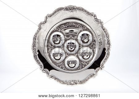 A Passover seder plate against a white background
