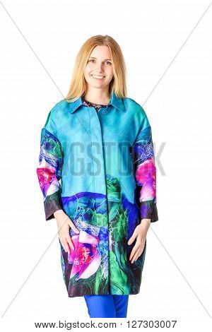 Girl in a coat looking at camera white background