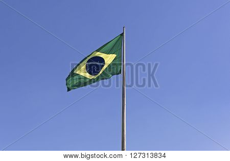 The National Flag of Brazil in blue sky background, horizontal