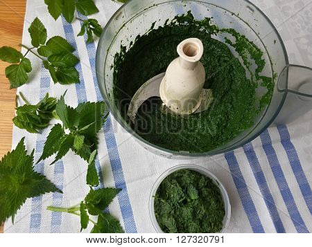 Cooking nettles ginger cake, nettle in food processor, organic food with wild plants and quail eggs