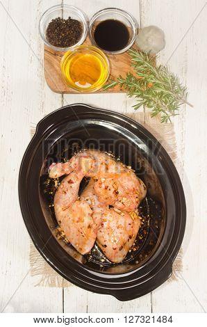 honey soya sauce garlic and black pepper marinated chicken leg in a crock pot