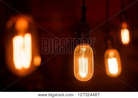 Vintage light bulbs with glower filament. Incandescent retro design.