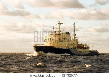 Large ice-breaker ship sailing in open sea