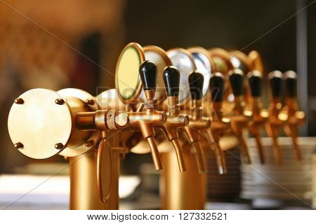 Draught beer taps in a bar. poster