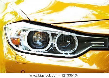 Headlights of yellow car
