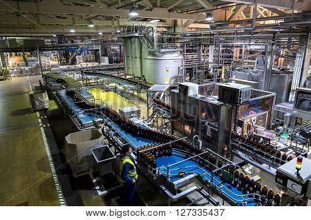 January 23 2016 .Saint-Petersburg.Conveyor with beer bottles at the Heineken brewery in St. Petersburg . Russia.