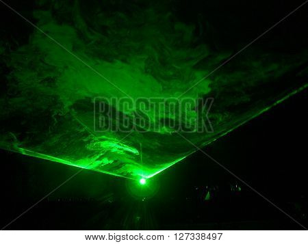 Wide green laser ray with smoke on black ** Note: Visible grain at 100%, best at smaller sizes