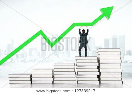 Education concept with businessman standing on book stairway and upholding green chart arrow on abstract city background. 3D Rendering