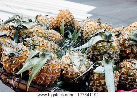 Basket With Pineapple From Street Vendor In Vietnam