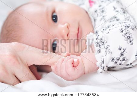 Baby Girl Grasping Her Parents Finger