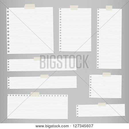 Pieces of cut out white lined notebook paper are stuck on gray background.