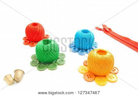 Thimbles, Spools Of Thread, Red Zipper And Plastic Buttons