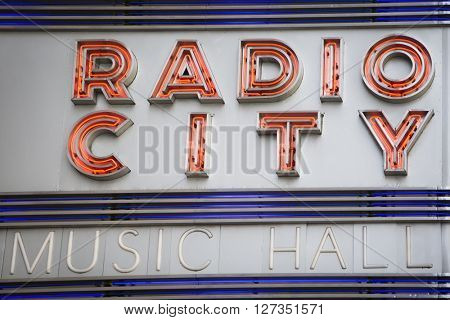 NEW YORK - 27 MAR 2016: Close up view of the iconic Radio City Music Hall neon sign above the entrance in Manhattan on March 27, 2016. The theater hosts the Christmas Spectacular with the Rockettes.